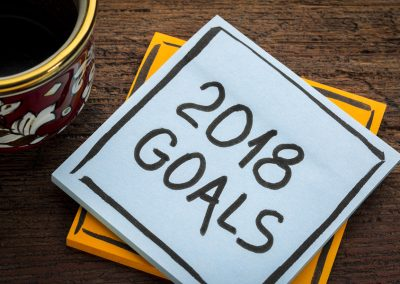 2018 goals - handwriting in black ink on a  sticky note with a